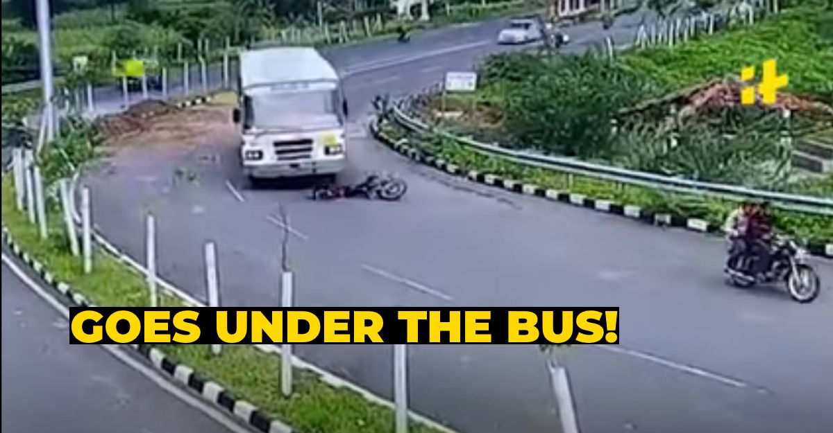 Biker has a narrow escape after getting mowed down by bus