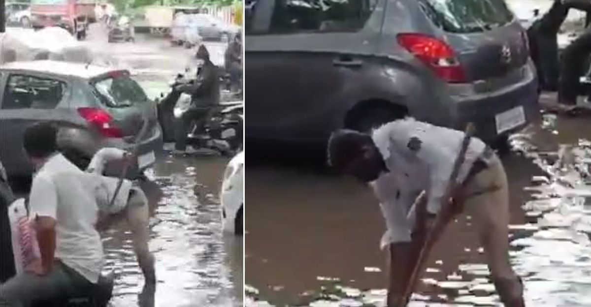 Pune traffic cop removes garbage from manhole to ensure smooth traffic flow
