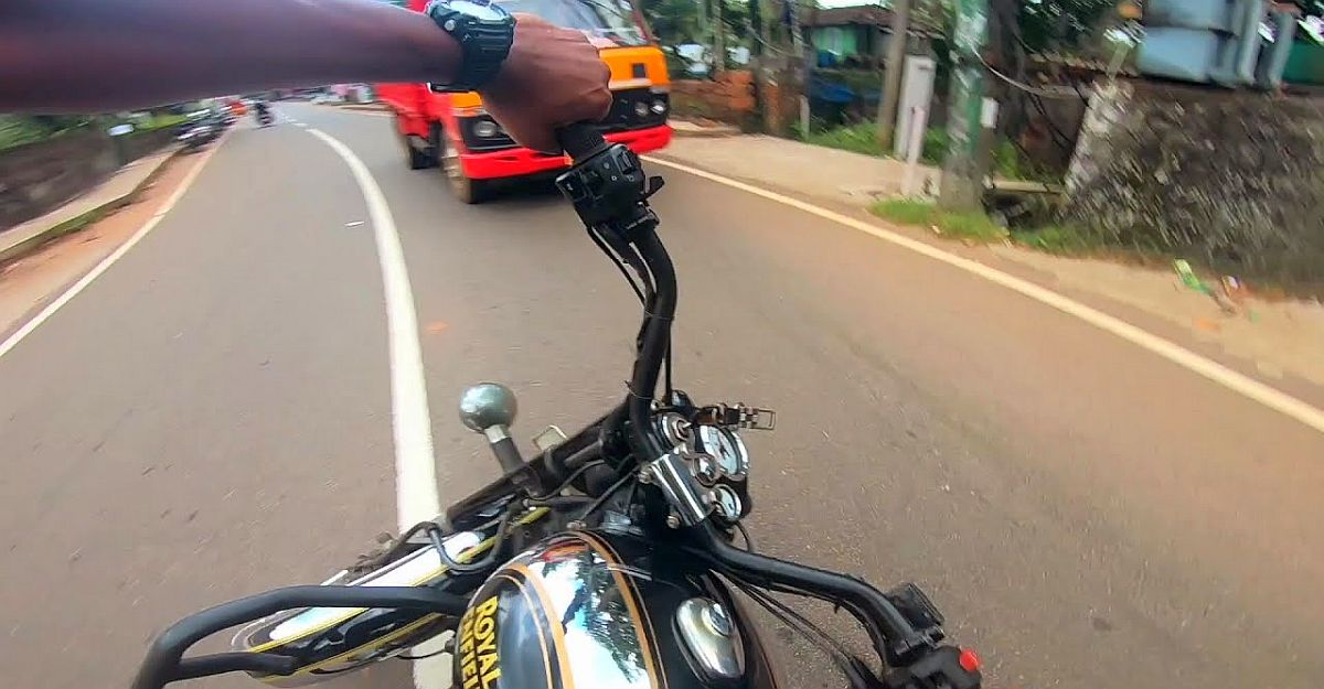 Royal Enfield Classic rider leant around a corner rides straight into an oncoming truck [Video]